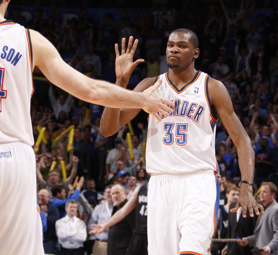 Oklahoma City\'s Kevin Durant (35) slaps hands after making a three-point basket to send the game into a second overtime during the NBA basketball game between the Oklahoma City Thunder and the Minnesota Timberwolves at Chesapeake Energy Arena in Oklahoma City, Friday, March 23, 2012. Photo by Bryan Terry, The Oklahoman
