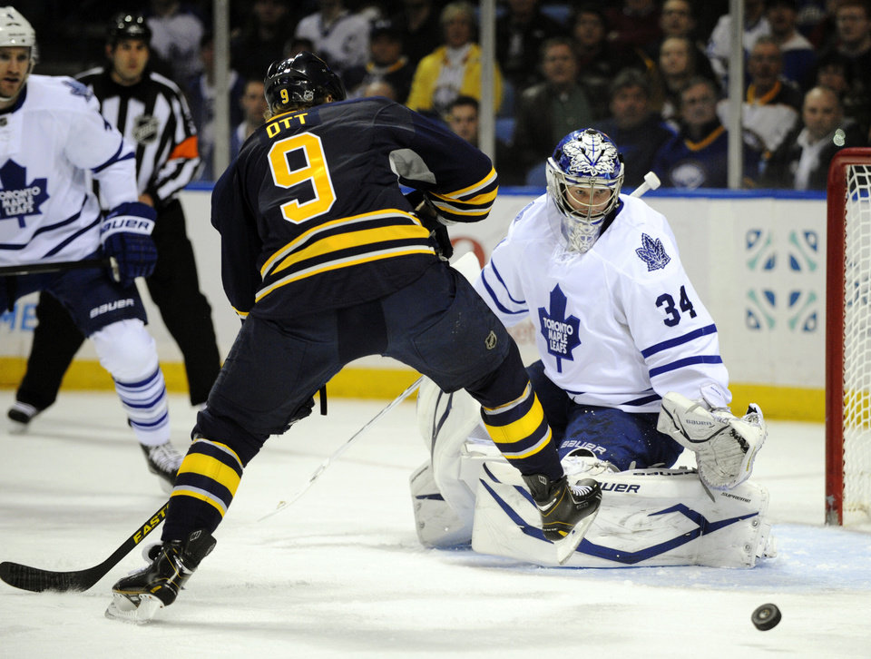 Buffalo Sabres' center Steve Ott (9) shoots on Toronto Maple Leafs goaltender James Reimer (34) during the first period of an NHL hockey game in Buffalo, N.Y., Thursday, March 21, 2013. (AP Photo/Gary Wiepert)