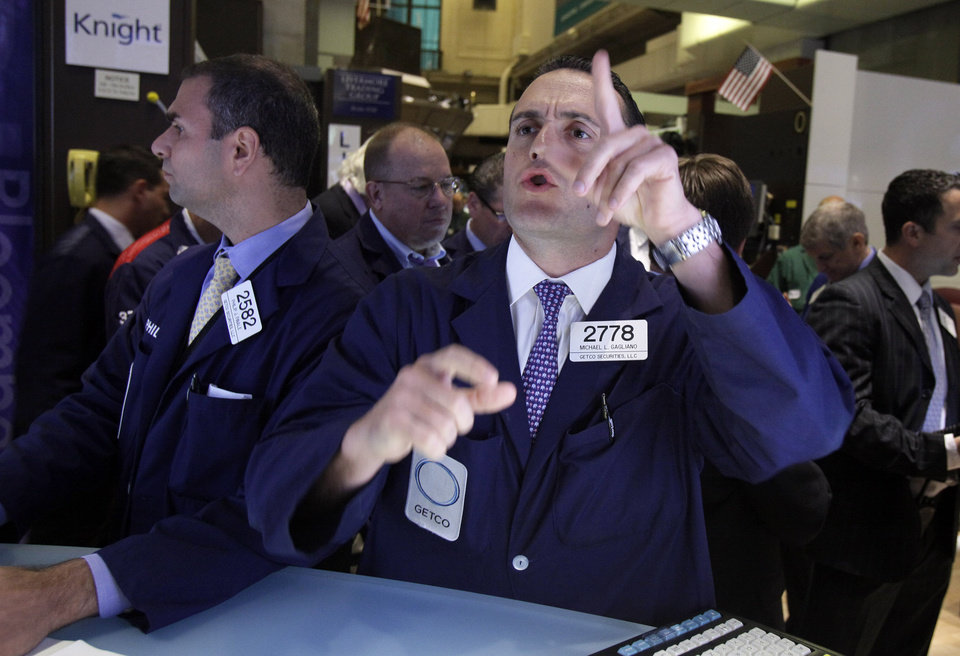 Photo -   FILE -- In a July 26, 2012 file photo specialist Michael Gagliano works at his post on the floor of the New York Stock Exchange. U.S. stocks edged higher Monday Aug. 6, 2012, on a day marked by uncharacteristic quiet following a turbulent week. (AP Photo/Richard Drew)