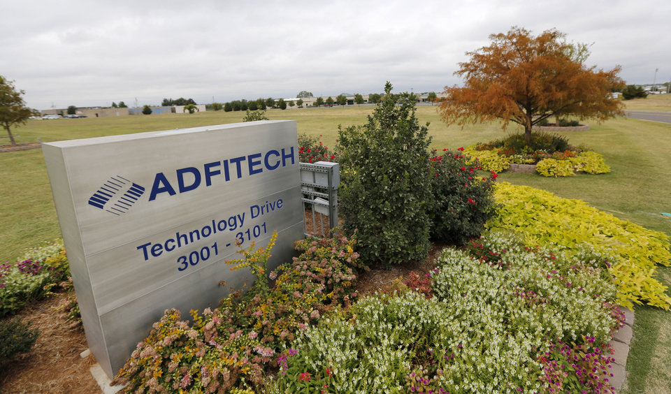 Photo - Adfitech Inc. a mortgage services company laid off 320 employees in Edmond, Friday October 18, 2013. Photo By Steve Gooch, The Oklahoman