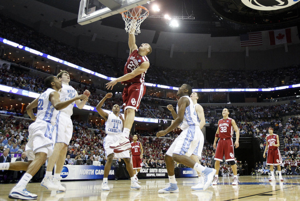 Photo - Oklahoma's Blake Griffin (23) dunks the ball over the North Carolina defense during the first half in the Elite Eight game of NCAA Men's Basketball Regional between the University of North Carolina and the University of Oklahoma at the FedEx Forum on Sunday, March 29, 2009, in Memphis, Tenn.