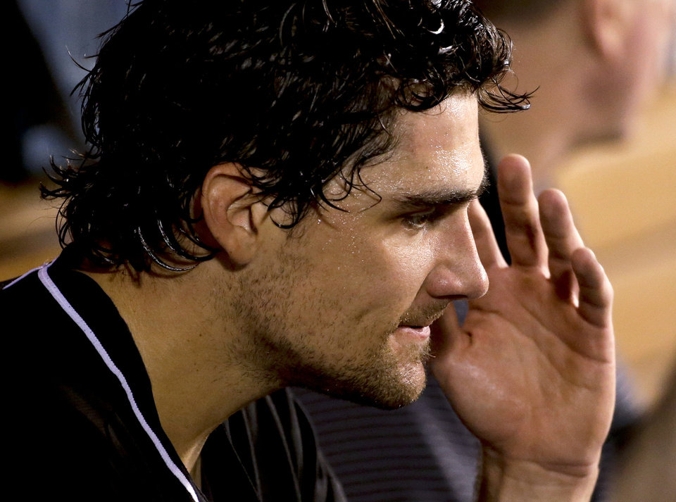 Photo - Miami Marlins starting pitcher Nathan Eovaldi reacts in the dugout after being taken out during the fourth inning of a baseball game against the Los Angeles Angels in Anaheim, Calif., Tuesday, Aug. 26, 2014. (AP Photo/Chris Carlson)