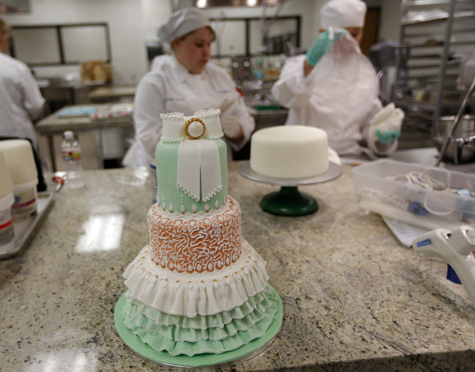 Photo - Students work on cakes at Francis Tuttle. Photo by Sarah Phipps, The Oklahoman