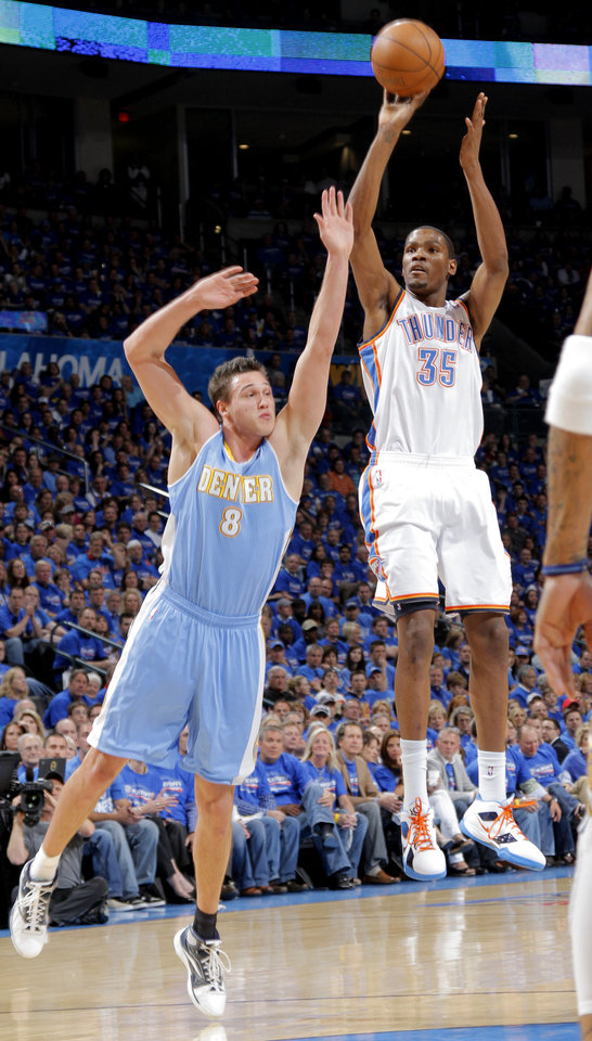 Photo - Oklahoma City's Kevin Durant (35) shoots the ball over Denver's Danilo Gallinari (8) during the first round NBA playoff game between the Oklahoma City Thunder and the Denver Nuggets on Sunday, April 17, 2011, in Oklahoma City, Okla. Photo by Chris Landsberger, The Oklahoman