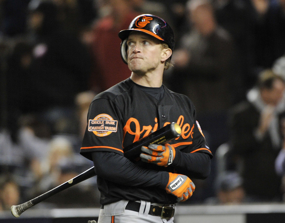 Photo -   Baltimore Orioles' Nate McLouth reacts after striking out with the bases loaded during the eighth inning of Game 5 of the American League division baseball series against the New York Yankees, Friday, Oct. 12, 2012, in New York. (AP Photo/Bill Kostroun)