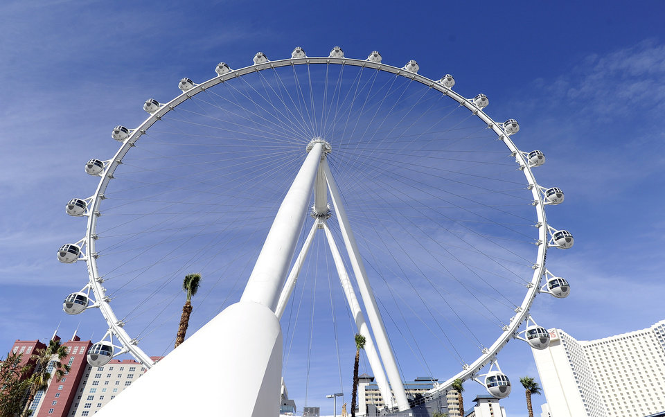 Photo - The Las Vegas High Roller at The LINQ is seen on Monday, March 31, 2014, in Las Vegas. The 550-foot-tall attraction, which opened to the public today, is the highest observation wheel in the world and features 28 cabins that can accommodate up to 40 people each. (AP Photo/David Becker)