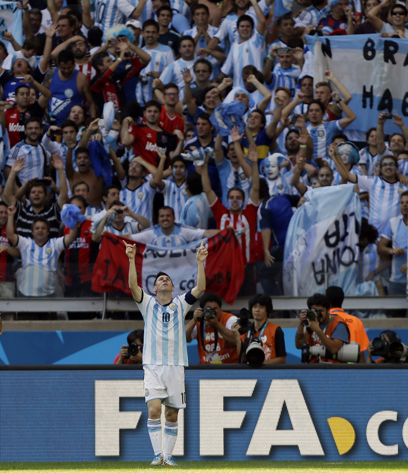 Photo - Argentina's Lionel Messi celebrates  after scoring his side's lone goal in Argentina's 1-0 victory over Iran during the group F World Cup soccer match between Argentina and Iran at the Mineirao Stadium in Belo Horizonte, Brazil, Saturday, June 21, 2014.  (AP Photo/Fernando Vergara)