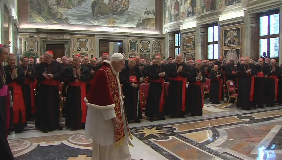 Photo - In this image taken from video as Pope Benedict XVI enters to deliver his final greetings to the assembly of cardinals at the Vatican Thursday Feb. 28, 2013, before he retires in just a few hours.  Benedict urged the cardinals to work in unity and promised his