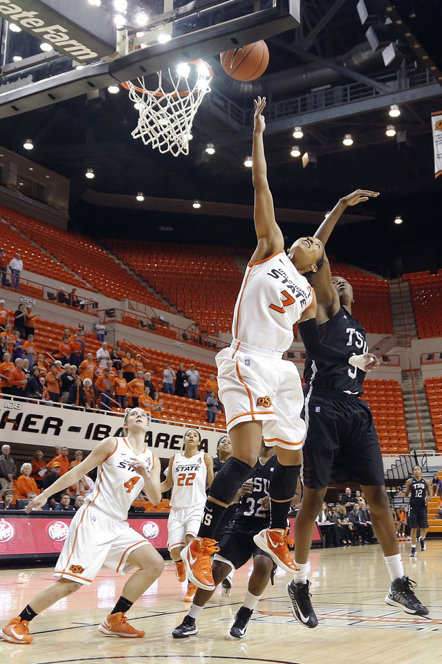 Oklahoma State 's Tiffany Bias (3) drives to the basket past Texas Southern 's Gianne Fleming (3) during the women's college basketball game between Oklahoma State University and Texas Southern University on Saturday, Dec. 1, 2012, in Stillwater, Okla.   Photo by Chris Landsberger, The Oklahoman