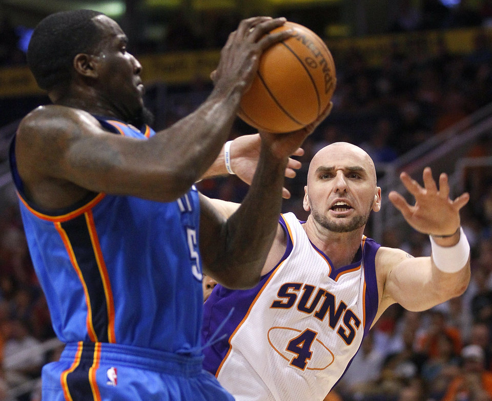 Oklahoma City Thunder center Kendrick Perkins battles Phoenix Suns center Marcin Gortat, of Poland, for the ball during the first half of an NBA basketball game, Wednesday, April 18, 2012, in Phoenix. (AP Photo/Matt York)  ORG XMIT: PNU101