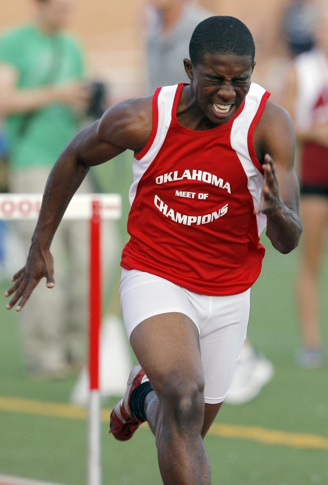 Photo - Del City's Airick Johnson races to the finish on his way to winning the boys 110-meter hurdles during the Oklahoma Meet of Champions track and field event at Moore High School in Moore, Okla., Tuesday, May 18, 2010. Photo by Nate Billings, The Oklahoman ORG XMIT: KOD