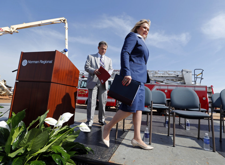 Photo - Governor Mary Fallin and Norman Regional Health System President David Whitaker take the stage at a one-year memorial ceremony and groundbreaking on Tuesday, May 20, 2014 in Moore, Okla.  Photo by Steve Sisney, The Oklahoman