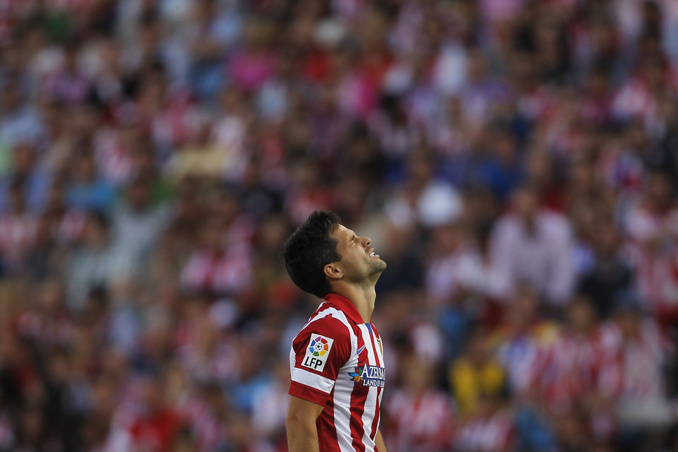 Photo - Atletico's Diego pauses,  during a Spanish La Liga soccer match between Atletico Madrid and Malaga at the Vicente Calderon stadium in Madrid, Spain, Sunday May 11, 2014. (AP Photo/Gabriel Pecot)
