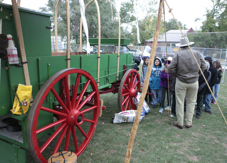 Photo - Students at Lincoln Elementary School in Norman look at  a wagon from the Oklahoma History Center.  It's the culmination of a weeklong study of pioneer history.  Photo By David McDaniel, The Oklahoman  David McDaniel - The Oklahoman
