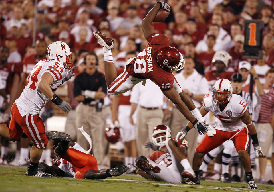 Oklahoma's Jermaine Gresham (18) is upended by the Nebraksa defense during the first half of the college football game between the University of Oklahoma Sooners (OU) and the University of Nebraska Huskers (NU) at the Gaylord Family Memorial Stadium, on Saturday, Nov. 1, 2008, in Norman, Okla. 