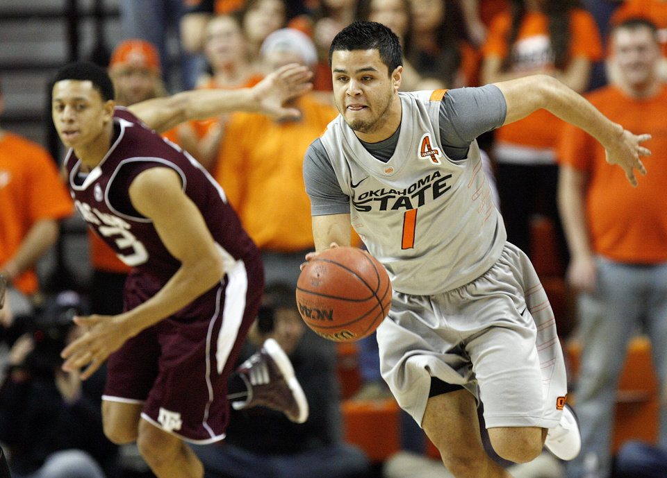 OSU's Cezar Guerrero (1) leads a fast break in front of Texas A&M's Jordan Green (13) in the first half during a men's college basketball game between the Oklahoma State University Cowboys and Texas A&M University Aggies at Gallagher-Iba Arena in Stillwater, Okla., Saturday, Feb. 25, 2012. OSU won, 60-42. Photo by Nate Billings, The Oklahoman