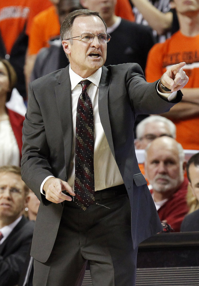 Photo - OU head coach Lon Kruger gives instructions to his team during the Bedlam men's college basketball game between the Oklahoma State University Cowboys and the University of Oklahoma Sooners at Gallagher-Iba Arena in Stillwater, Okla., Monday, Jan. 9, 2012. Photo by Nate Billings, The Oklahoman