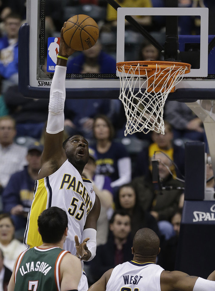 Photo - Indiana Pacers' Roy Hibbert (55) dunks during the first half of an NBA basketball game against the Milwaukee Bucks, Thursday, Feb. 27, 2014, in Indianapolis. (AP Photo/Darron Cummings)