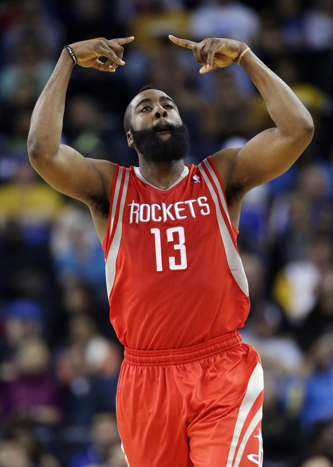 Houston Rockets\' James Harden (13) reacts after making a three-point basket against the Golden State Warriors during the second half of an NBA basketball game in Oakland, Calif., Tuesday, Feb. 12, 2013. Houston won 116-107. (AP Photo/Marcio Jose Sanchez)