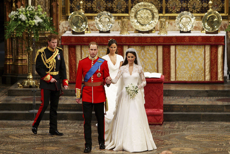 Photo - Britain's Prince William, front left, and his wife Kate, the Duchess of Cambridge, front right, leave Westminster Abbey after their wedding, followed by Britain's Prince Harry, William's best man, back left, and maid of honour Philippa Middleton, center back, in London, Friday, April 29, 2011. (AP Photo/Dave Thompson, Pool) ORG XMIT: RWDA113