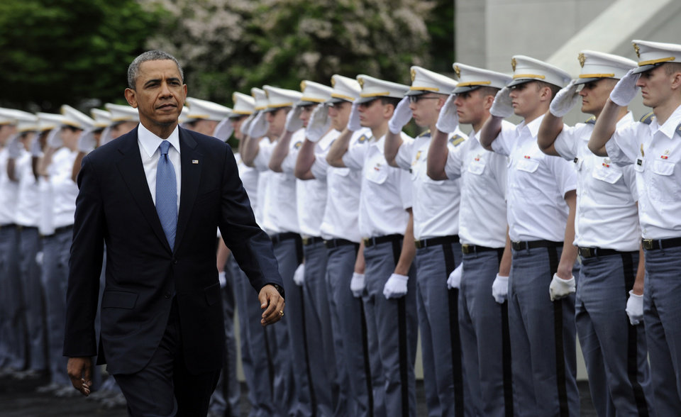 Photo - President Barack Obama arrives to deliver the commencement address to the U.S. Military Academy at West Point's Class of 2014, Wednesday, May 28, 2014, in West Point, N.Y., Wednesday, May 28, 2014. In a broad defense of his foreign policy, the president declared  that the U.S. remains the world's most indispensable nation, even after a