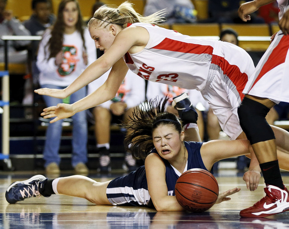 Shawnee's Micaela Yu (25) loses the ball as she hits the court underneath Carl Albert's Asher Sutterfield (23) during a Class 5A girls high school basketball game in the semifinals of the state tournament at the Mabee Center in Tulsa, Okla., Friday, March 8, 2013. Shawnee defeated Carl Albert, 50-46, in overtime. Photo by Nate Billings, The Oklahoman