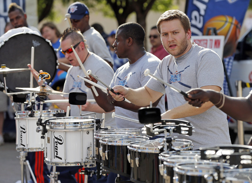 Photo - The Thunder Drummers perform outside of the arena before Game 6 of the Western Conference Finals in the NBA playoffs between the Oklahoma City Thunder and the San Antonio Spurs at Chesapeake Energy Arena in Oklahoma City, Saturday, May 31, 2014. Photo by Nate Billings, The Oklahoman
