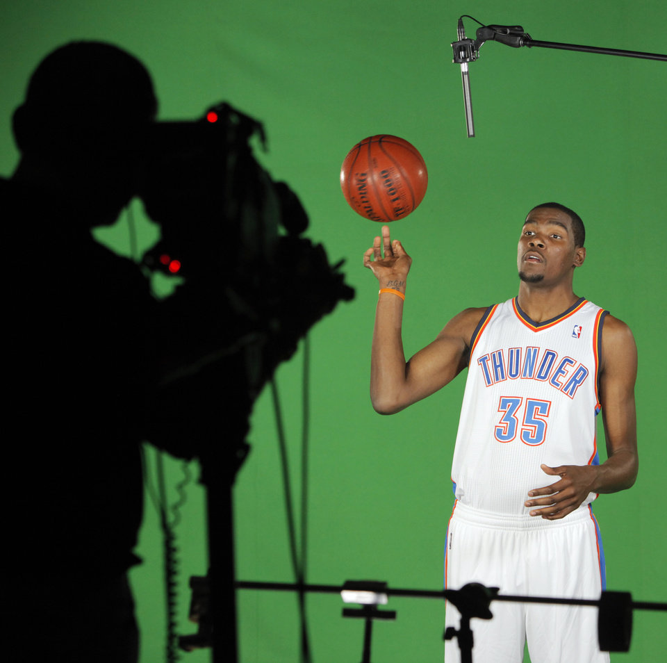 Photo - Kevin Durant spins the ball for a video shoot during media day for the Oklahoma City Thunder at the Ford Center in downtown Oklahoma City, Monday, Sept. 27, 2010. Photo by Nate Billings, The Oklahoman