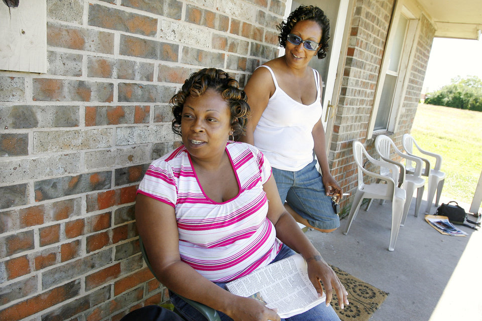 Photo - Sisters Cleta Jennings, Antwun Parker's mother, and Sharon Jennings, Antwun's aunt, on Sharon's front porch talk about Antwun in Oklahoma City Friday, May 29, 2009. Parker, 16, was killed by pharmacist Jerome Jay Ersland during an attempted robbery of Reliable Discount Pharmacy, 5900 S Pennsylvania Ave, on May 19, 2009. Photo by Paul B. Southerland, The Oklahoman