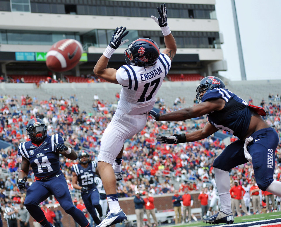 Photo - A pass is incomplete to Evan Engram (17) as Deterrian Shackelford (38) moves in during Mississippi's Grove Bowl controlled football scrimmage at Vaught-Hemingway Stadium in Oxford, Miss., Saturday, April 5, 2014. (AP Photo/Oxford Eagle, Bruce Newman) MAGAZINES OUT; NO SALES; MANDATORY CREDIT