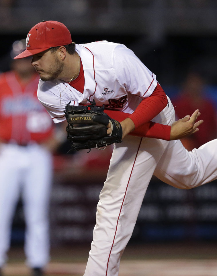Photo - Louisiana Lafayette pitcher Carson Baranik (44) pitches in the first inning of an NCAA college baseball tournament super regional game against Mississippi in Lafayette, La.,Sunday, June 8, 2014. (AP Photo/Gerald Herbert)