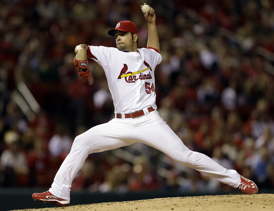 Photo -   St. Louis Cardinals starting pitcher Jaime Garcia throws during the fifth inning of a baseball game against the Cincinnati Reds, Monday, Oct. 1, 2012, in St. Louis. (AP Photo/Jeff Roberson)