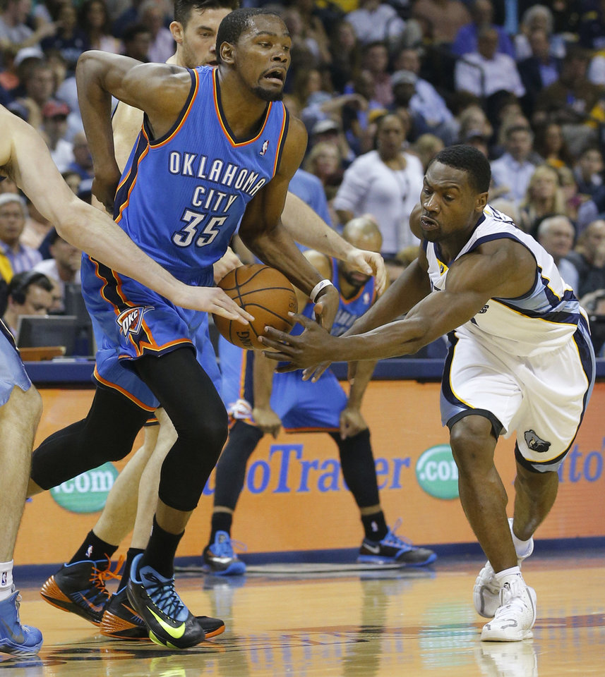Photo - Memphis' Tony Allen (9) defends Oklahoma City's Kevin Durant (35) during Game 3 in the first round of the NBA playoffs between the Oklahoma City Thunder and the Memphis Grizzlies at FedExForum in Memphis, Tenn., Thursday, April 24, 2014. Photo by Bryan Terry, The Oklahoman