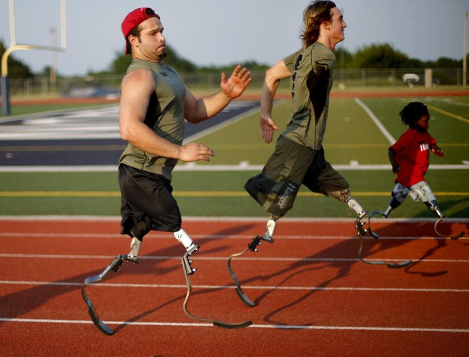 Photo -  Ugur Yumuk of Turkey, left, with Cameron Clapp of California, and Harvey Parry of the United Kingdom train in Edmond, Okla., Wednesday, June 8, 2011. Yumuk will be running during the Endeavor games for the first time. Photo by Bryan Terry, The Oklahoman