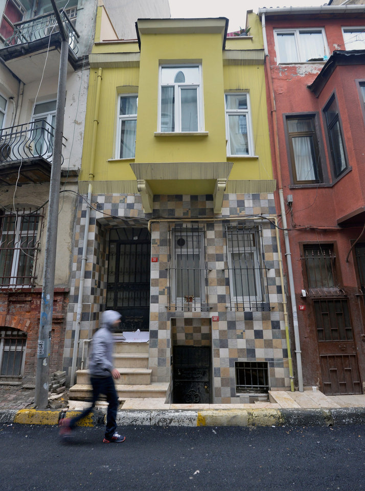 Photo - A view of the street with the hostel, in yellow, , Tuesday, Jan. 29, 2013 where Sarai Sierra, a New York City woman, 33, was staying in Istanbul, Turkey. Turkish police have released Tuesday security camera footage of  Sierra who has gone missing while vacationing alone in Istanbul. Sierra has been missing since Jan. 21, when she was supposed to return to New York but was not on her flight back home.(AP Photo)