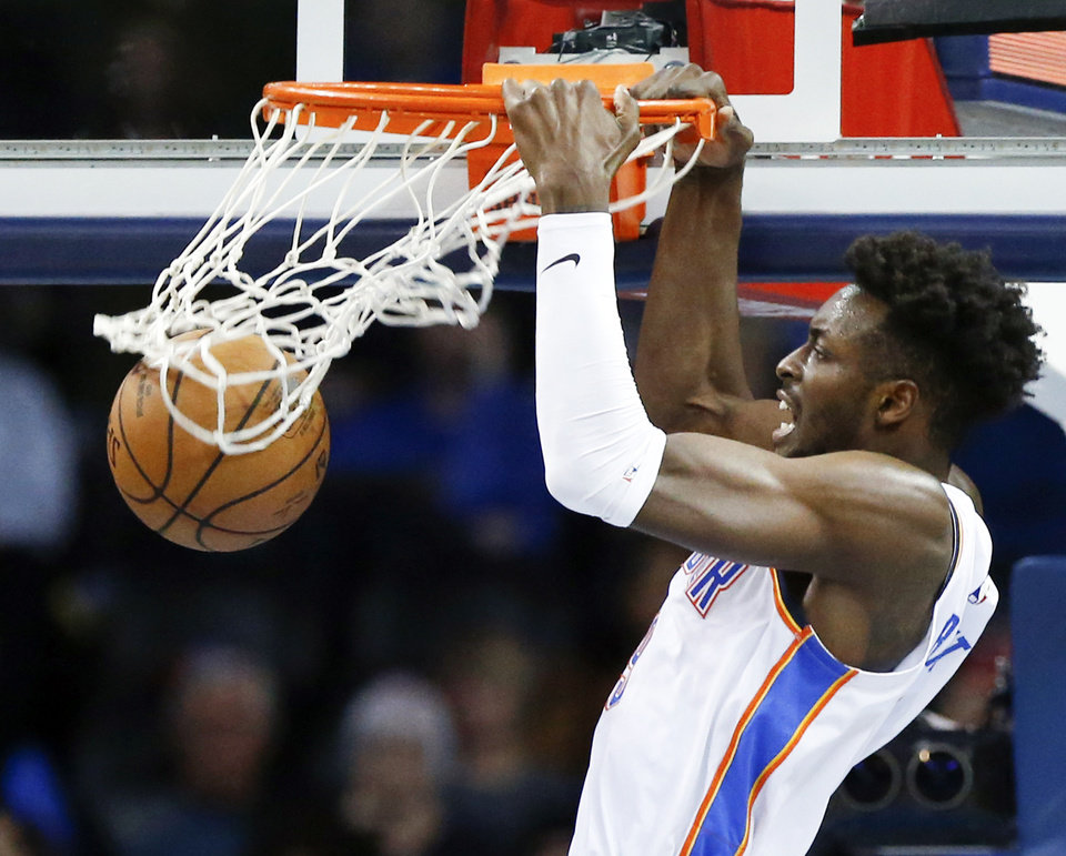 Photo - Oklahoma City's Jerami Grant (9) dunks during an NBA basketball game between the Utah Jazz and the Oklahoma City Thunder at Chesapeake Energy Arena in Oklahoma City, Monday, Dec. 10, 2018. Photo by Nate Billings, The Oklahoman