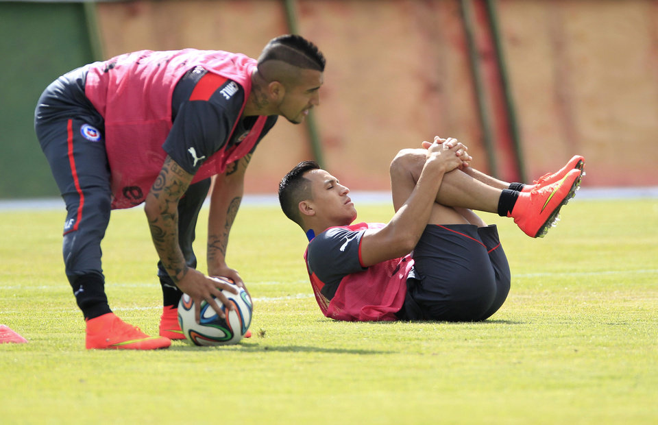 Photo - Chile's Alexis Sanchez, right, and teammate Arturo Vidal train with their team for the World Cup in Belo Horizonte, Brazil, Wednesday, June 11, 2014. The international soccer tournament starts Thursday. (AP Photo/Bruno Magalhaes)