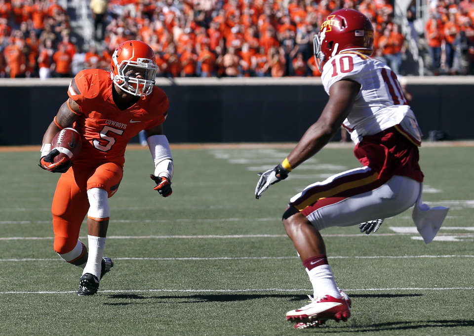 Photo - Oklahoma State's Josh Stewart (5) looks to get by Iowa State's Jacques Washington (10) during a college football game between Oklahoma State University (OSU) and Iowa State University (ISU) at Boone Pickens Stadium in Stillwater, Okla., Saturday, Oct. 20, 2012. Photo by Sarah Phipps, The Oklahoman
