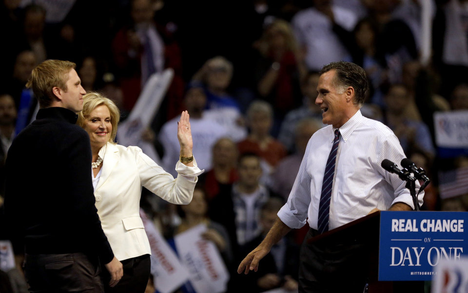Ann Romney, second from left, waves goodbye as she walks off stage with son Ben Romney, as her husband Republican presidential candidate, former Massachusetts Gov. Mitt Romney, right, prepares to speak at a campaign event at the Verizon Wireless Arena, Monday, Nov. 5, 2012, in Manchester, N.H. (AP Photo/David Goldman)