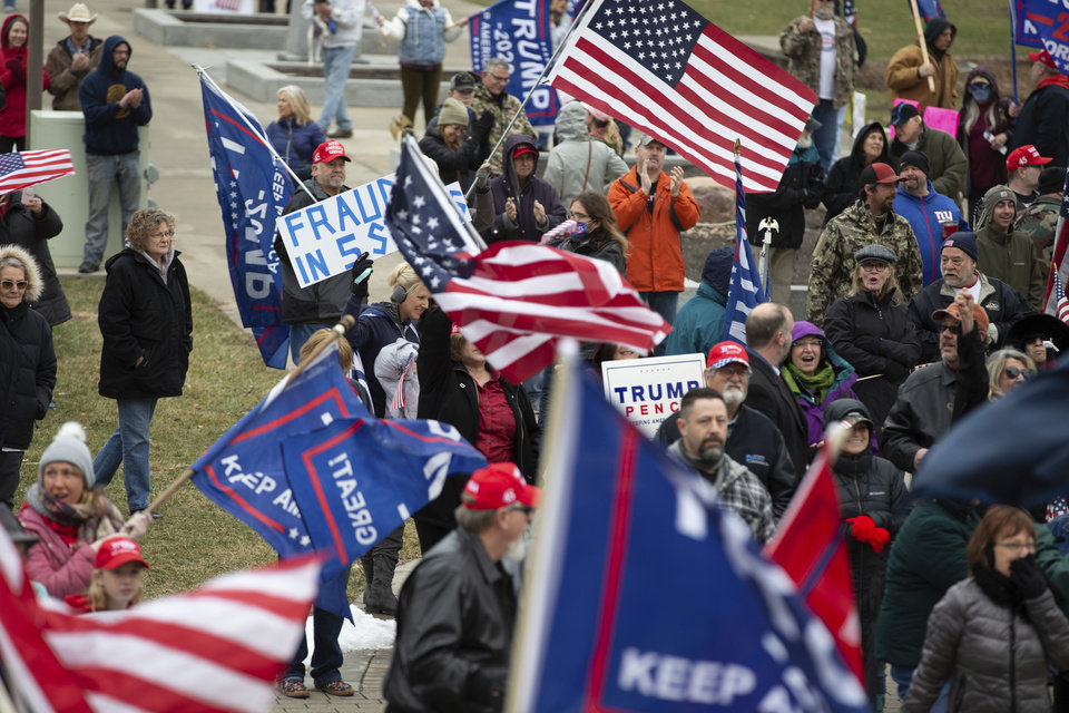 Photo - Supporters of President Donald Trump attend a rally outside the Kansas Statehouse, Wednesday, Jan. 6, 2021, in Topeka, Kan. (Evert Nelson/The Topeka Capital-Journal via AP)