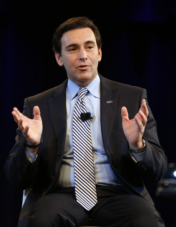 Photo - Ford Motor Company Chief Operating Officer Mark Fields speaks during a news conference in Dearborn, Mich., Thursday, May 1, 2014. Ford announced Fields will replace CEO Alan Mulally when he retires July 1. (AP Photo/Paul Sancya)