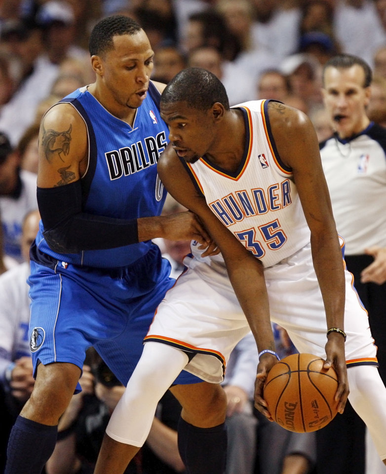 Oklahoma City\'s Kevin Durant (35) works against Dallas\' Shawn Marion (0) during Game 2 of the first round in the NBA basketball playoffs between the Oklahoma City Thunder and the Dallas Mavericks at Chesapeake Energy Arena in Oklahoma City, Monday, April 30, 2012. Photo by Nate Billings, The Oklahoman