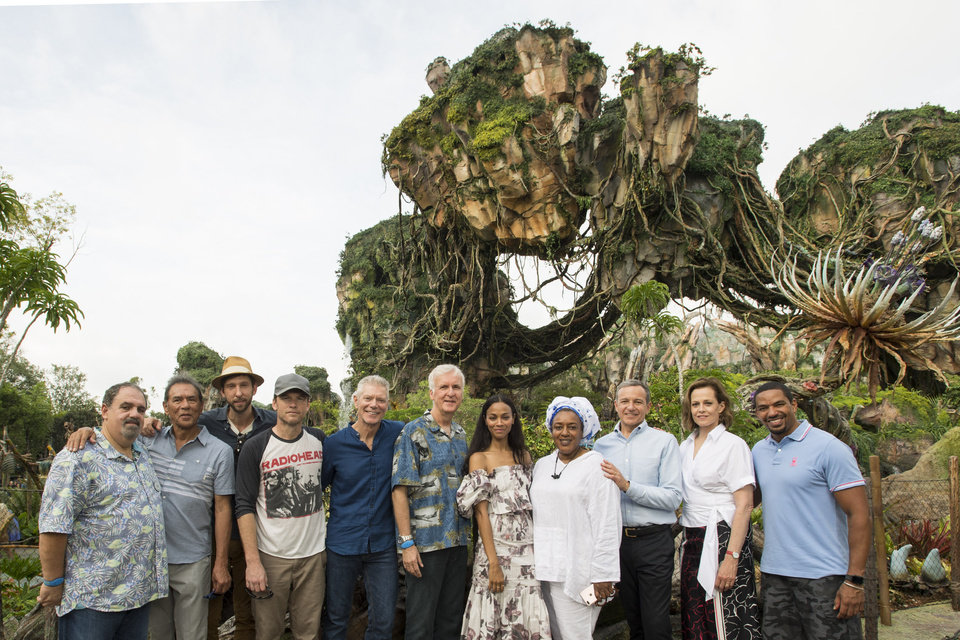 Photo - (L-R) Jon Landau, Wes Studi, Joel David Moore, Sam Worthington, Stephen Lang, James Cameron, Zoe Saldana, CCH Pounder, Bob Iger, Sigourney Weaver and Laz Alonso pose during the dedication of the new land, Pandora – The World of Avatar, at Disney's Animal Kingdom. Walt Disney Pandora – The World of Avatar brings a variety of exciting experiences to the park, including the family friendly attraction Na'vi River Journey, the exhilarating 3-D attraction Avatar Flight of Passage, as well as dining and merchandise locations. (Matt Stroshane, photographer)
