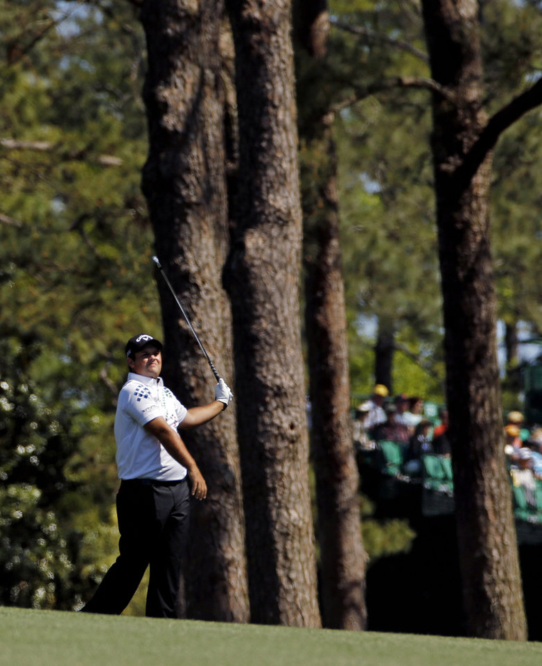 Photo - Patrick Reed watches his shot on the third fairway during the first round of the Masters golf tournament Thursday, April 10, 2014, in Augusta, Ga. (AP Photo/Matt Slocum)