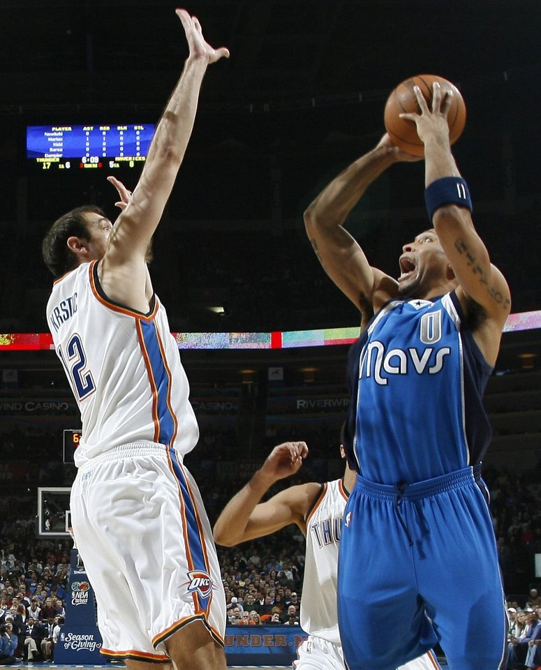 Photo - Shawn Marion of Dallas shoots the ball in front of Oklahoma City's Nenad Krstic during the NBA basketball game between the Oklahoma City Thunder and the Dallas Mavericks at the Ford Center in Oklahoma City on Wednesday, December 16, 2009. Photo by Bryan Terry, The Oklahoman