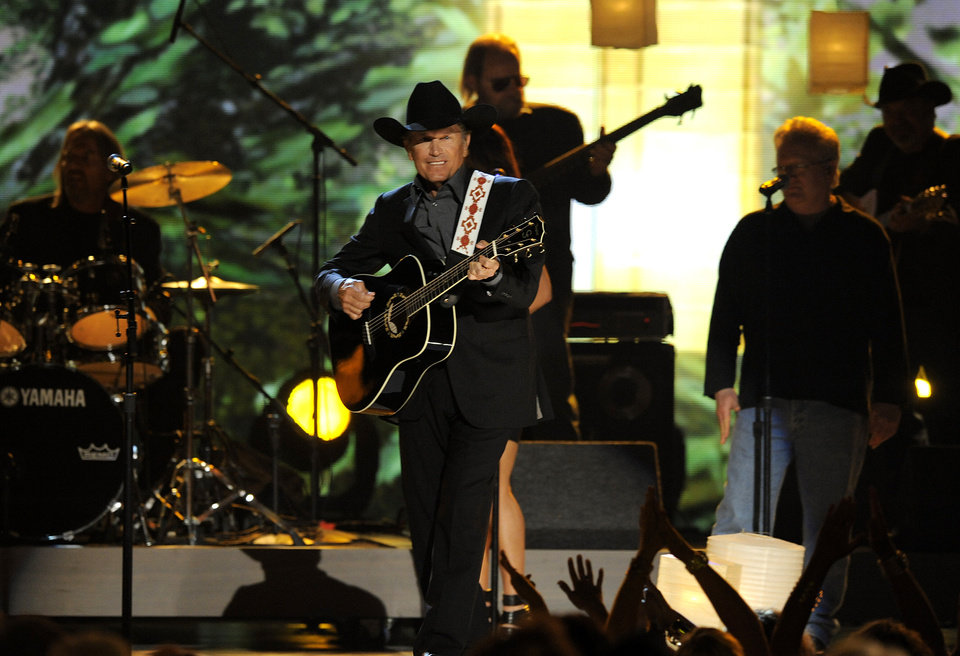Singer George Strait performs at the 48th Annual Academy of Country Music Awards at the MGM Grand Garden Arena in Las Vegas on Sunday, April 7, 2013. (Photo by Chris Pizzello/Invision/AP) ORG XMIT: NVPM211
