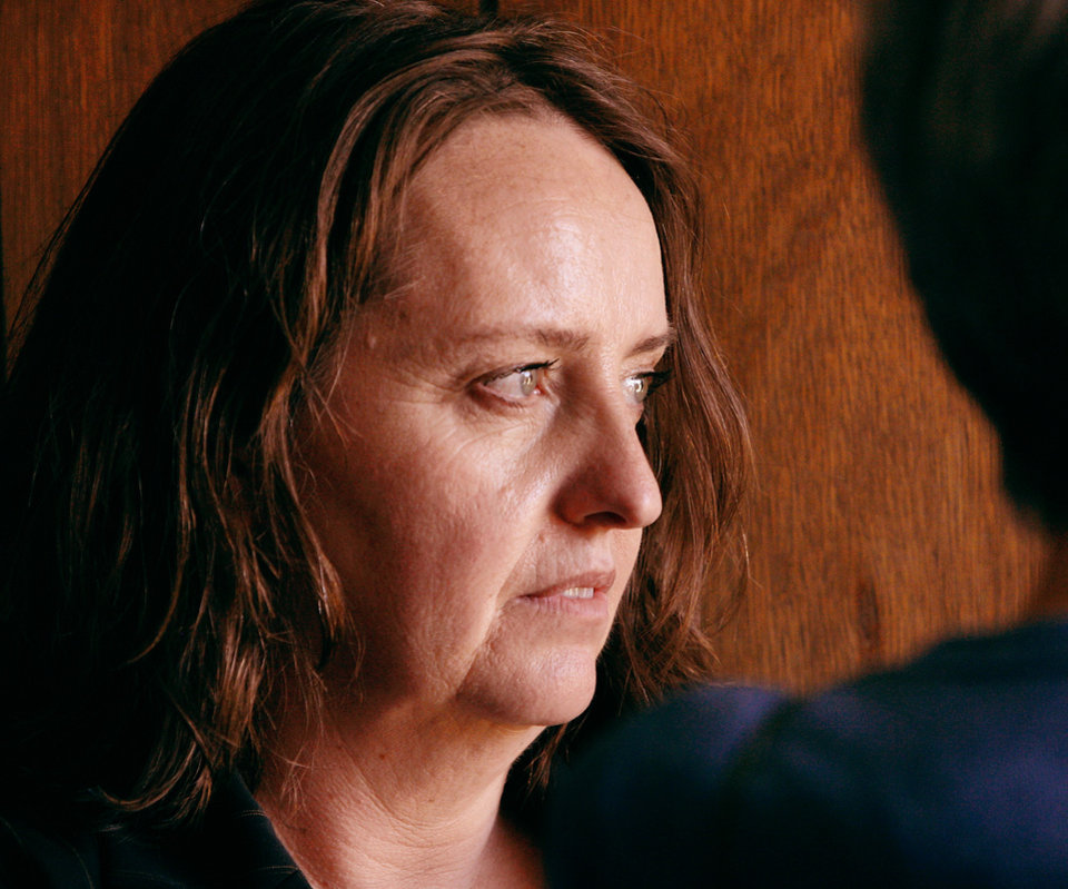 Bobbi Parker is seen minutes before a guilty verdict was returned against her by the jury.  Jurors returned a guilty verdict and recommended a one-year sentence to punish Bobbi Parker on a charge of aiding prison inmate Randolph Dial escape from the Oklahoma State Reformatory in 1994. Dial died in 2007.   Parker is led from the the Greer County Courthouse in Mangum , Okla. and taken to the county jail where she will be held until her sentencing.  The verdict was given about 2:30 Wednesday afternoon, Sep. 21, 2011. Photo by Jim Beckel, The Oklahoman
