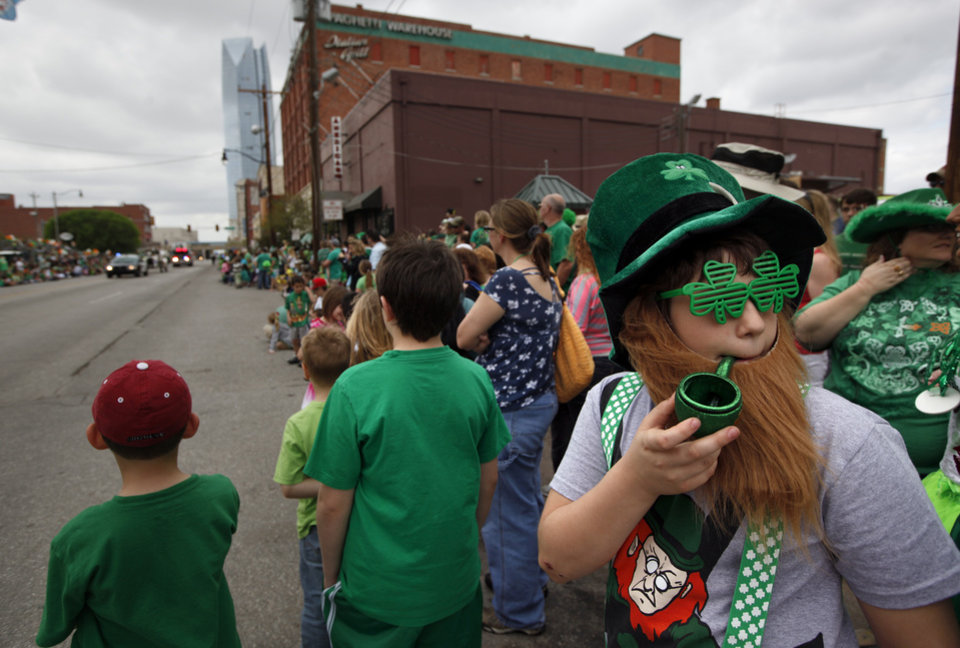 Mason Lancaster, 12, of Oklahoma City, watches the St. Patrick's Day Parade in Oklahoma City, Saturday, March 17, 2012. Photo by Sarah Phipps, The Oklahoman.