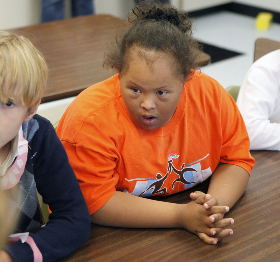 Photo - Special needs student Wendy Viney listens to instructor Angie Absher on Thursday at Johnson Elementary School. Photo by Paul Hellstern, The Oklahoman  PAUL HELLSTERN