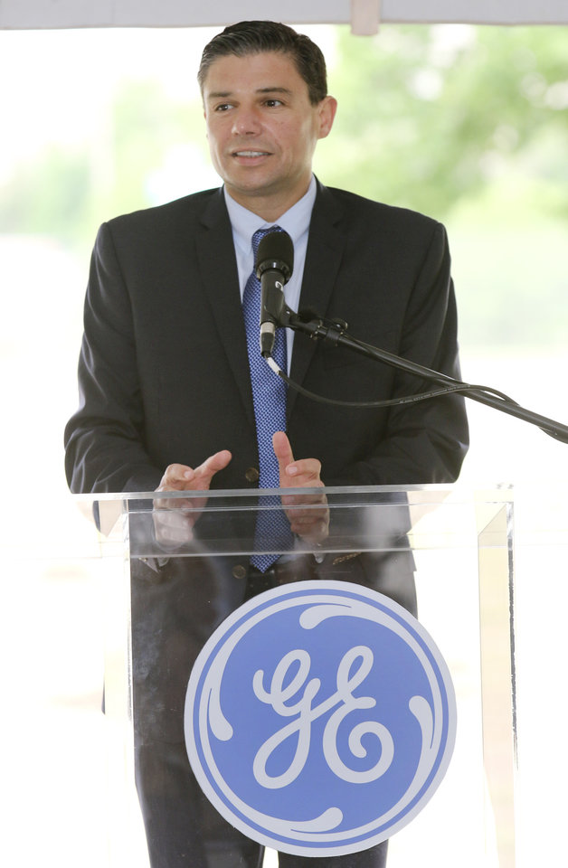 Photo -  Lorenzo Simonelli, president and CEO of GE Oil and Gas, speaks at the groundbreaking ceremony for the new Global Research Center. Photo by Steve Gooch, The Oklahoman   Steve Gooch -  The Oklahoman